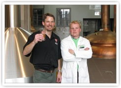 Panel member Alex Puchner with Brouwerij Bavik brewer Yves Benoit at his brewery in Belgium.